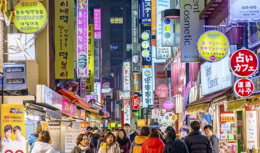 Seoul, South Korea - February 14, 2013: Crowds enjoy the Myeong-Dong district at night. The district is known as one of the main shopping and tourism areas.